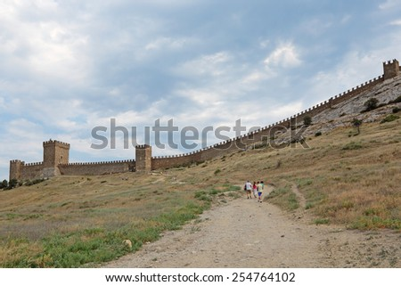 SUDAK, REPUBLIC OF CRIMEA, RUSSIA - AUG 07, 2014: The ruins of the medieval Genoese fortress in Sugdeya city (currently - Sudak) - stock photo