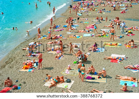 SUDAK, UKRAINE - SEPT 08, 2015: People at a sea beach in Sudak. According to National Geographic, Crimea was among the top 20 travel destinations in 2013 - stock photo