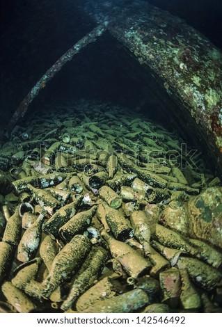 SUDAN, Red Sea, U.W. photo, Umbria wreck, italian wine bottles in the hold of the sunken ship - FILM SCAN - stock photo
