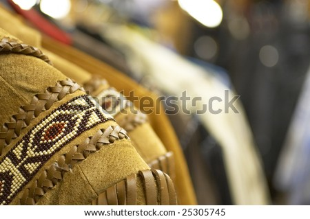 Suede and leather fringe jackets with bead work. - stock photo