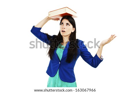 Suffering girl holding a book over his head. Isolated on white background  - stock photo