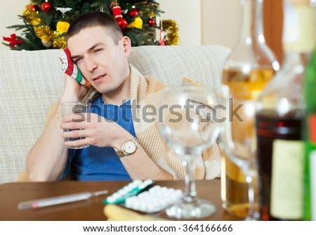 Suffering   man  stuping  towel to head in his living room - stock photo