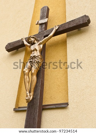 Suffering of Jesus Christ on the wooden cross - stock photo