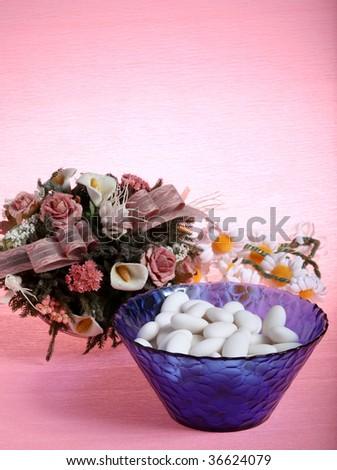 sugar almond and flowers - weddings - stock photo