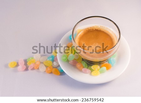 sugar and a small cup of coffee