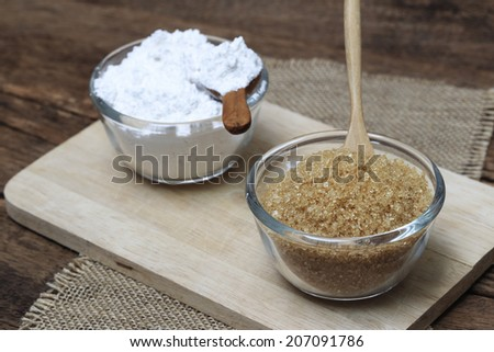Sugar and Rice powder in wooden bowl - stock photo