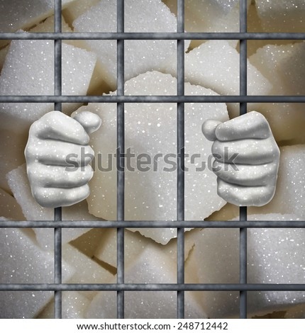 Sugar ban concept as cubes of sweet white granules behind bars in jail as a symbol for the health risk of sweeteners in our diet. - stock photo