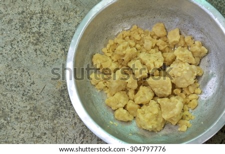 sugar blocks in a stainless steel bowl on cement background. - stock photo