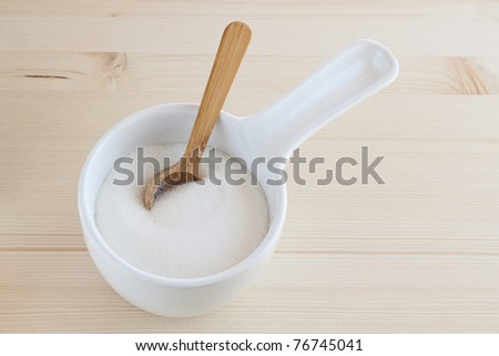 sugar bowl with a wooden spoon