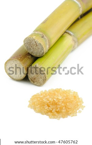 Sugar cane and brown sugar over white background - stock photo