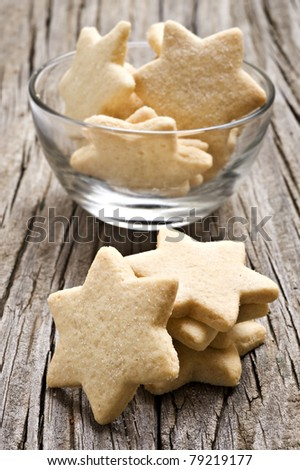Sugar coated shortbread cookies in star shapes stacked up - stock photo
