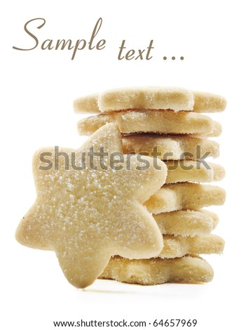 Sugar coated shortbread cookies in star shapes stacked up - on a white background with space for text - stock photo