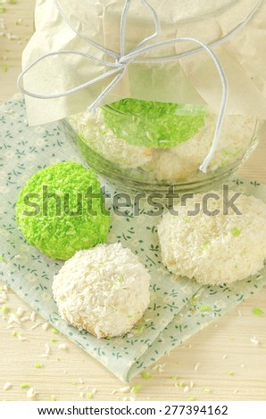 Sugar cookies with coconut flakes in glass jar. Near napkin. Selective focus - stock photo