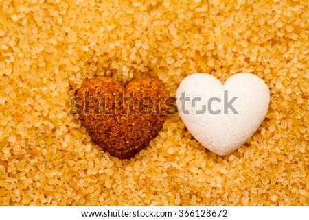 Sugar crystals from sugar cane and sugar heart - stock photo