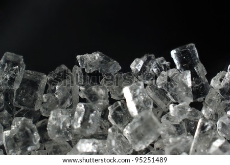 sugar crystals on a black background close-up