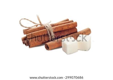 sugar cube and cinnamon - stock photo