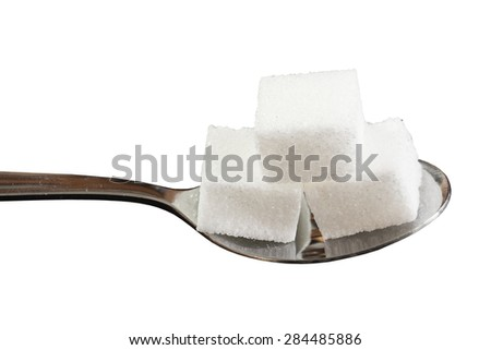 Sugar cube on a spoon - stock photo