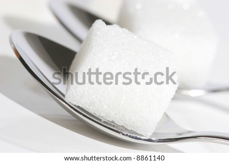 sugar cube on spoon