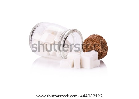 Sugar cubes in a glass bottle.