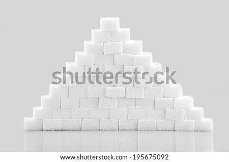 Sugar cubes isolated on gray  background - stock photo
