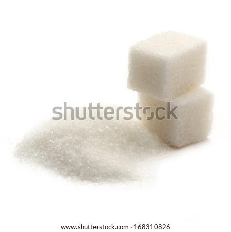 Sugar cubes on white background - stock photo