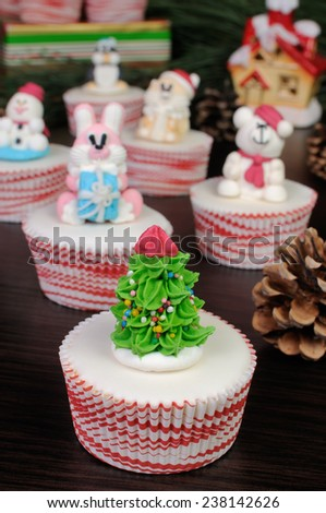 Sugar figurine Christmas tree on the glazed muffin