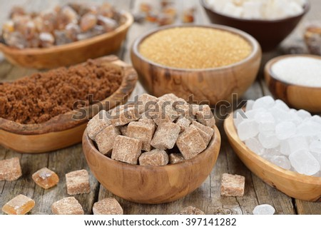 Sugar in a bowl on a brown background - stock photo
