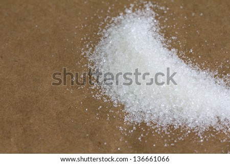 sugar on a cardboard background papers. macro...