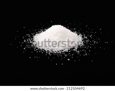Sugar on black background  - stock photo
