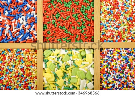 sugar spreading pastry and rainbow sprinkles for decoration cake - stock photo