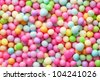Sugar sprinkle dots, decoration for confectionery. High magnification macro. - stock photo