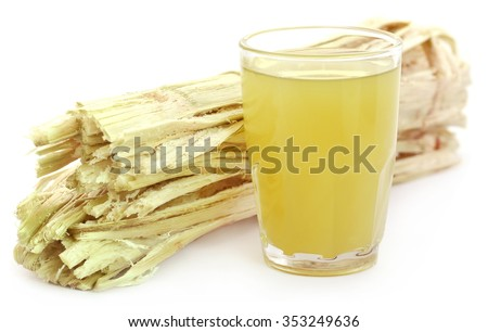 Sugarcane juice with bagasse over white background