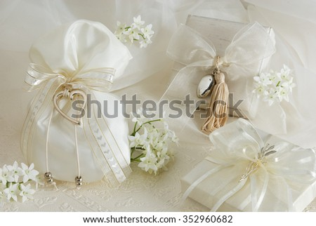 sugared almonds on traditional pouches for a christian wedding - stock photo