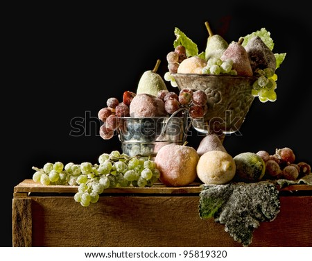 Sugared fruit still life, fruit with a sugar glaze, Christmas or Autumn seasons, black background and room for copy space. - stock photo