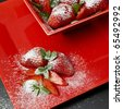 sugared strawberries with mint leaves - stock photo
