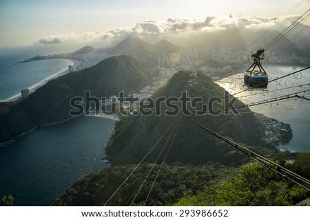 Sugarloaf Mountain Rio de Janeiro Brazil cable car gondola city skyline - stock photo