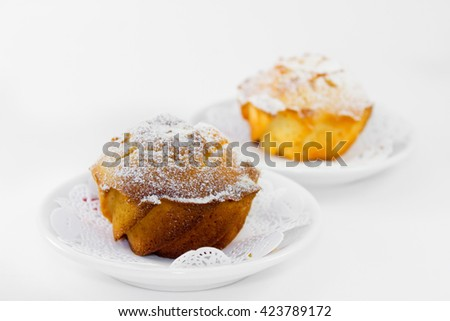 sugary muffins isolated on a white background. Sweet cakes in the cafe. Cozy atmosphere - stock photo
