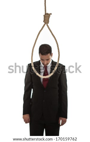Suicidal businessman contemplating hanging standing looking at a hangmans noose - stock photo