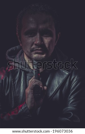 Suicide, Assassin, man with black coat and gun - stock photo