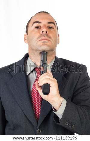 Suicide concept -  man pointing a gun at his head, white background - stock photo