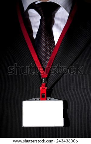 Suit and Name Tag - stock photo