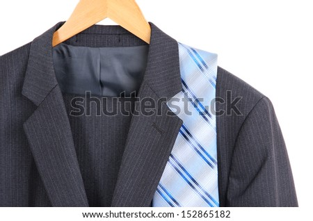 Suit and tie on hanger on white background - stock photo