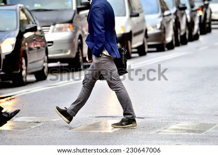 Suit (man) in silhouette walking on the street. - stock photo