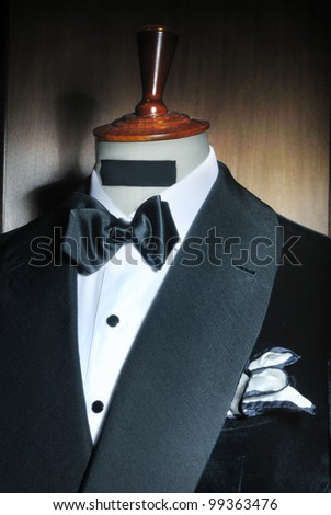 suit very stylish with bow tie close up on a wooden gradient background
