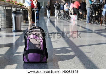 suitcase in the airport - stock photo