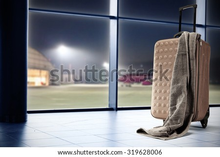 suitcase of brown color and towel  - stock photo