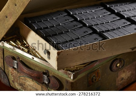 Suitcase of gun magazines and bullets - stock photo