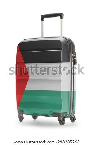 Suitcase painted into national flag - Palestine