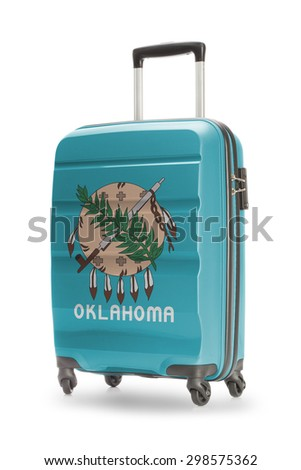 Suitcase painted into US state flag - Oklahoma - stock photo