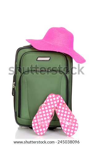 suitcase with beach hat and sandals - stock photo